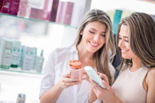 women smiling at shampoo labels