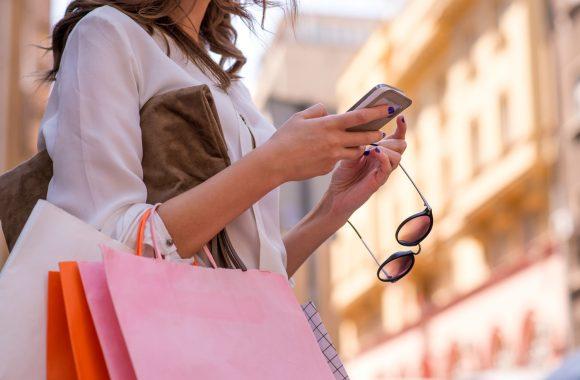 Woman Shopping looking at phone